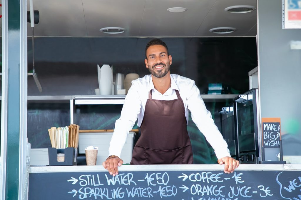 man with food truck business